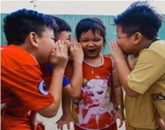 Children sharing secrets